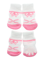 Pink / White Bow Tie Pet Socks - These fun and functional doggie socks protect your dogs paws from mud, snow, ice, hot pavement, hot sand and other extreme weather. Made from 95% cotton & 5% spandex making them comfortable and secure. Each sock features a paw shaped anti-slip silica pad & help keep your house sanitary. (set of 4).